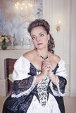 Beautiful young woman in black and white medieval dress Stock Photography