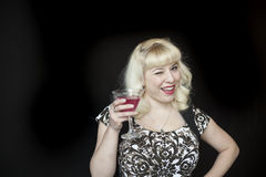 Beautiful Young Woman with Blond Hair Drinking a Pink Martini Royalty Free Stock Photos