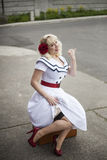 Beautiful Young Woman with Blond Hair Hitchhiking Stock Photos