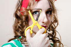 Beautiful young woman blond pinup girl & scissors Royalty Free Stock Image