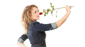 Beautiful young woman blonde in jeans romantic red rose isolated Stock Image