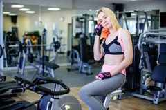 Beautiful young woman blonde resting after a cardio workout. Stock Photo
