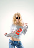 Beautiful young woman blonde in t-shirt and jeans on white backg Royalty Free Stock Photo