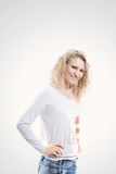 Beautiful young woman blonde in t-shirt and jeans on white background. Beautiful young woman blonde t-shirt and jeans on white background Royalty Free Stock Images