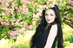 Beautiful young woman in blooming gardens Royalty Free Stock Photos