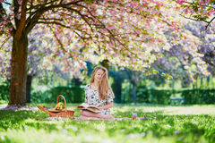 Beautiful young woman in blooming spring park Royalty Free Stock Photography