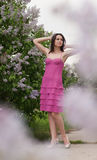 Beautiful young woman & blooming spring pink lilac Stock Photography