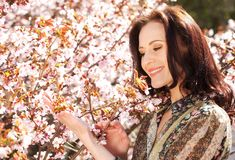Beautiful young woman in blossom garden Royalty Free Stock Photography