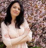 Beautiful young woman in blossom garden Stock Photos