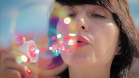Beautiful young woman blowing bubble outdoor happy. Lifestyle HD stock video footage