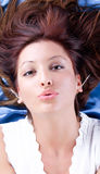 Beautiful young woman blowing a kiss Stock Photos