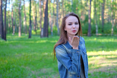 Beautiful Young Woman Blowing A Kiss, outdoor Royalty Free Stock Photography