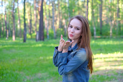 Beautiful Young Woman Blowing A Kiss, outdoor Stock Images