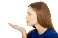 Beautiful young woman blowing a kiss. Beautiful teenage woman blowing a kiss Stock Photos