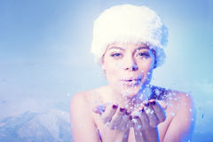 Beautiful young woman blowing winter snow Stock Photography