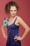 Beautiful young woman in a blue Stock Photo