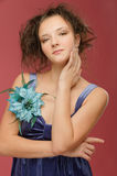 Beautiful young woman in a blue Royalty Free Stock Photography