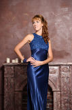 Beautiful young woman in a blue dress Stock Images