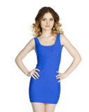 Beautiful young  woman in a blue dress posing on a white backgro Royalty Free Stock Images