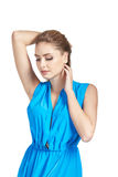 Beautiful young woman in blue dress raised her hands up and looking down Stock Photography