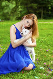 Beautiful young woman in blue dress Stock Images