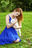 Beautiful young woman in blue dress Stock Image