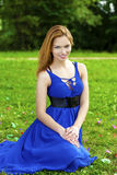 Beautiful young woman in blue dress Royalty Free Stock Photography