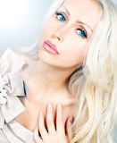 Beautiful young woman with blue eyes and long curly blond hair Stock Image
