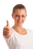 Beautiful young woman with blue eyes showing thumb up Royalty Free Stock Image