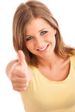 Beautiful young woman with blue eyes showing thumb up Stock Photo