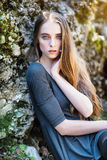 Beautiful young woman with blue eyes at sunset time Royalty Free Stock Images