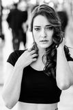 Beautiful young woman with blue eyes in urban background Stock Photography