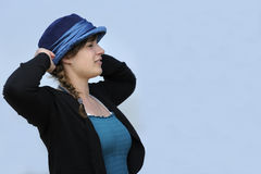 Beautiful young woman with blue hat Royalty Free Stock Photo