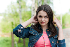 Beautiful young woman with blue jeans jacket Stock Photography