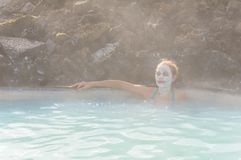 Beautiful young woman in Blue Lagoon geothermal spring , Iceland Stock Images