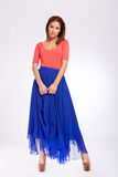 Beautiful young woman in blue long dress Stock Image
