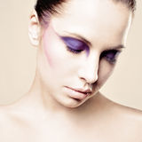 Beautiful young woman with blue make-up. Royalty Free Stock Image