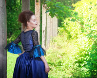 Beautiful young  woman in blue medieval dress Stock Photo