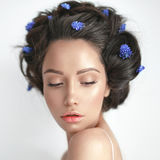Beautiful young woman with blue muscari in her hair Stock Images