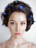 Beautiful young woman with blue muscari in her hair Stock Photos