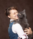 Beautiful young woman with blue Russian cat. Love for pet. Studio photo. stock photo