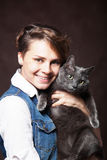 Beautiful young woman with blue Russian cat. Love for pet. Studi Stock Photography