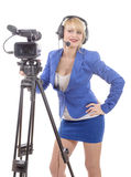 Beautiful young woman with blue suit and professional video came. A beautiful young woman with blue suit and professional video camera Royalty Free Stock Photo