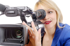 Beautiful young woman with blue suit and professional video came. A beautiful young woman with blue suit and professional video camera Royalty Free Stock Image