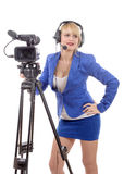 Beautiful young woman with blue suit and professional video came. A beautiful young woman with blue suit and professional video camera Stock Photography
