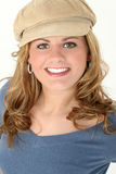Beautiful Young Woman in Blue Sweater and Cap stock images