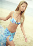Beautiful young woman in blue swimsuit with pareo Stock Images