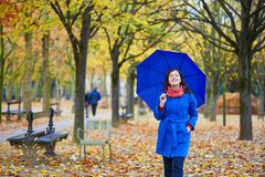 Beautiful young woman with blue umbrella royalty free stock images