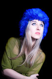 Beautiful young woman in blue winter hat Royalty Free Stock Photography