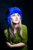 Beautiful young woman in blue winter hat Royalty Free Stock Photos